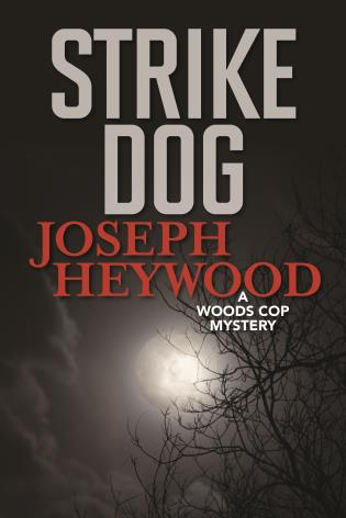Cover image for the book Strike Dog: A Woods Cop Mystery