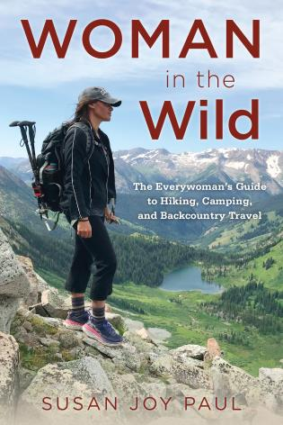 Cover image for the book Woman in the Wild: The Everywoman's Guide to Hiking, Camping, and Backcountry Travel