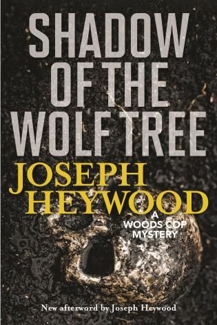 Cover image for the book Shadow of the Wolf Tree: A Woods Cop Mystery, New Edition