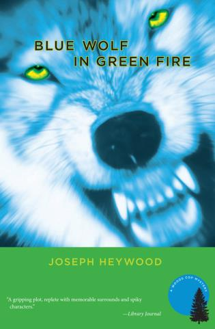 Cover image for the book Blue Wolf In Green Fire: A Woods Cop Mystery